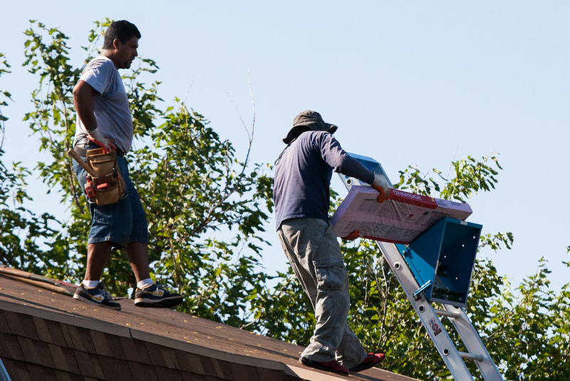 Roofers on a home in Oklahome City, OK.