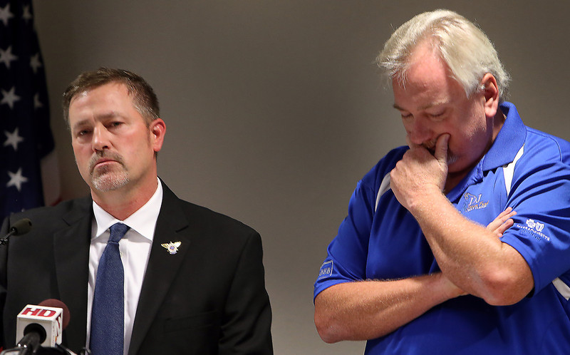 Tranport Workers Union of America Organizing Department Director Fran McCann Jr. listens as Dale Daker, TWU President, answers questions at a press conference after the Department of Justice announced Tuesday that it will attempt to block the merger of American Airlines and US Airways.