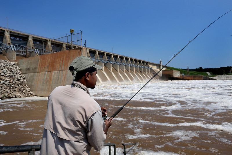 Robert Steelman fishes at the base of the Keystone Dam.