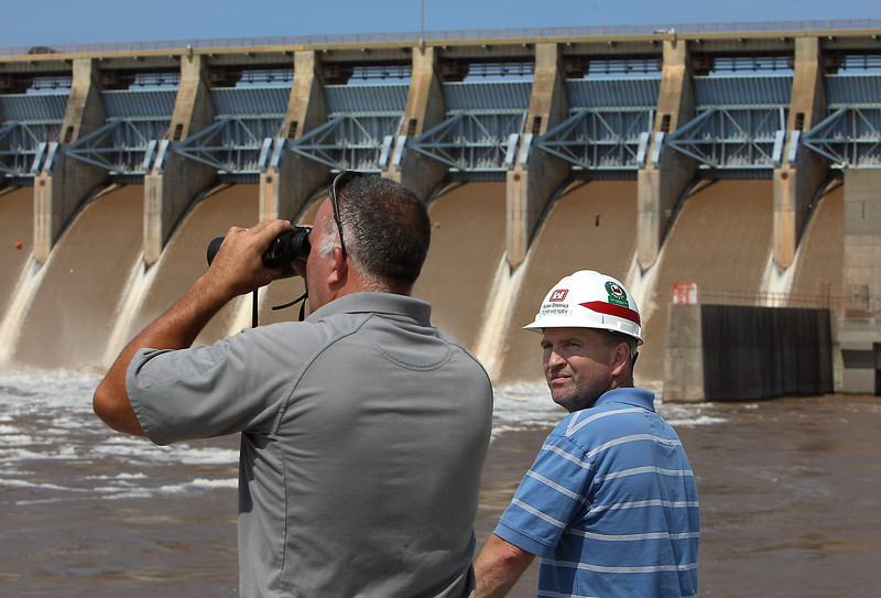 William Jefferies, Keystone Lake Manager and Powerhouse manger Tom Henry observe maintenance work being performed on the Keystone Dam.