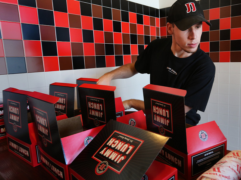 Jimmy Johns employee Dillon Boyd prepares a catering order.