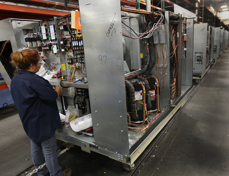 An AAON employees assembles an industrial air-conditioning unit at the companies Tulsa plant.  AAON announced its operating results for the second quarter, sales and earnings during the quarter were record highs for any quarter in the Company's history.