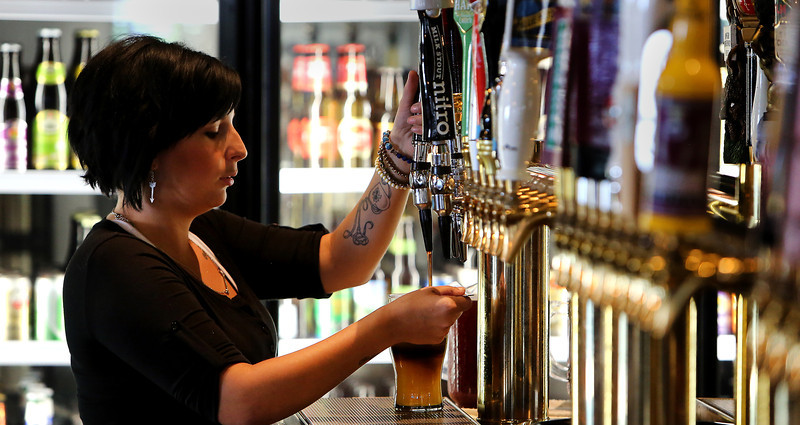 Mcnellies South City Bartender Sally Caveny serves up lunchtime drinks for customers.