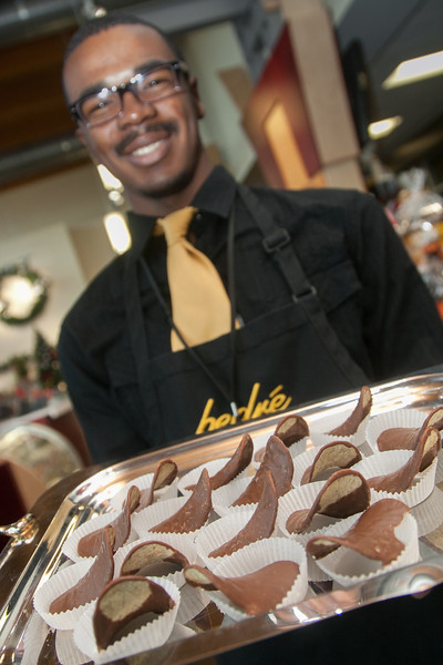 Desmond James at Bedre Chocolate serves up their best selling chocolate covered chips.