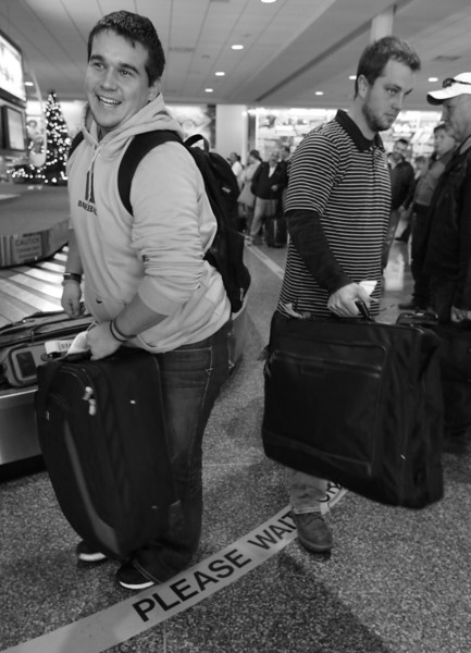 Travelers at the Tulsa International Airport claim their baggage after a flight from Dallas Thursday.  Flights were at 100 percent capacity on Thursday at Will Rogers World Airport and will be full leaving Tulsa International Airport on Friday on what is expected to a record holiday travel season.