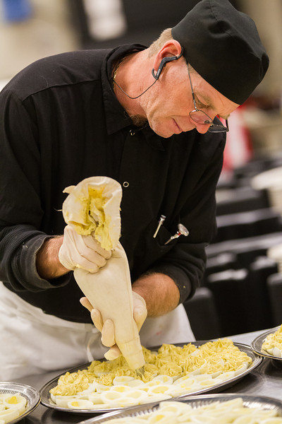 Daniel Bishop prepares food for a holiday party at the Reed Center in Midwest City.