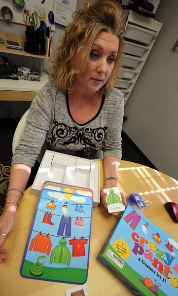 Audiologist Jacque Scholl has launched the Tulsa-based toy company Chatterbox Toys and is seen here with its first product, the children's board game Crazy Pants.