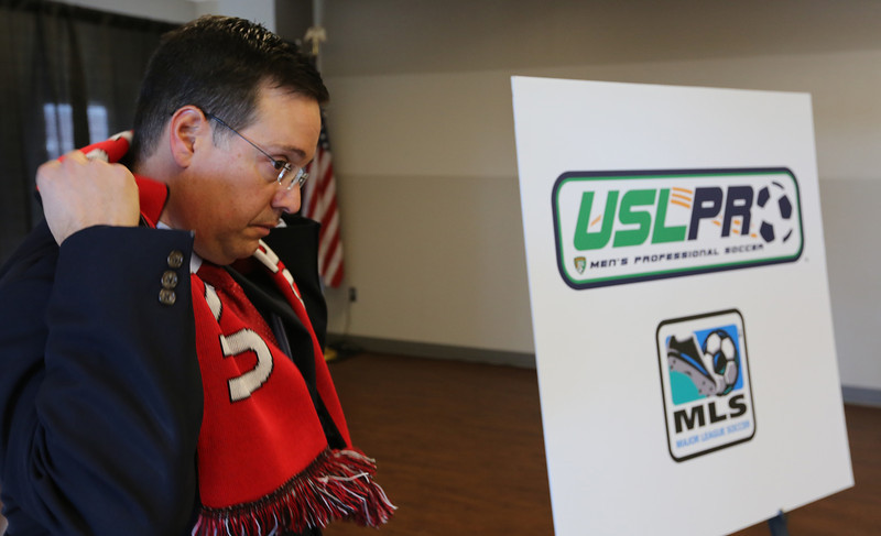 Tulsa Drillers General Manager Mike Melega wears a scarf in celebration that the USL PRO has announced an expansion franchise in Tulsa and  will join the league for the 2015 season. The Tulsa Drillers of Minor League Baseball will be majority owners of the team with Prodigal LLC of Oklahoma City holding a minority interest in the squad.
