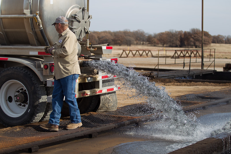 Greg Roberts removes water from drilling sites and takes it to a disposal facility at Bullet Energy Services, llc.