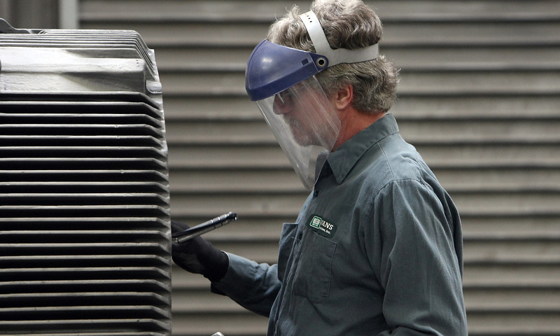 David Ferrell works to rebuild an electric motor at Evans Enterprises Tulsa location. <br /> <br /> *** They are Expanding ***