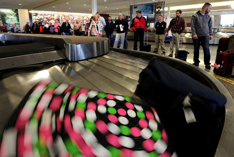 Travelers at the Tulsa International Airport wait on baggage Thursday.  Flights were at 100 percent capacity on Thursday at Will Rogers World Airport and will be full leaving Tulsa International Airport on Friday on what is expected to a record holiday travel season.