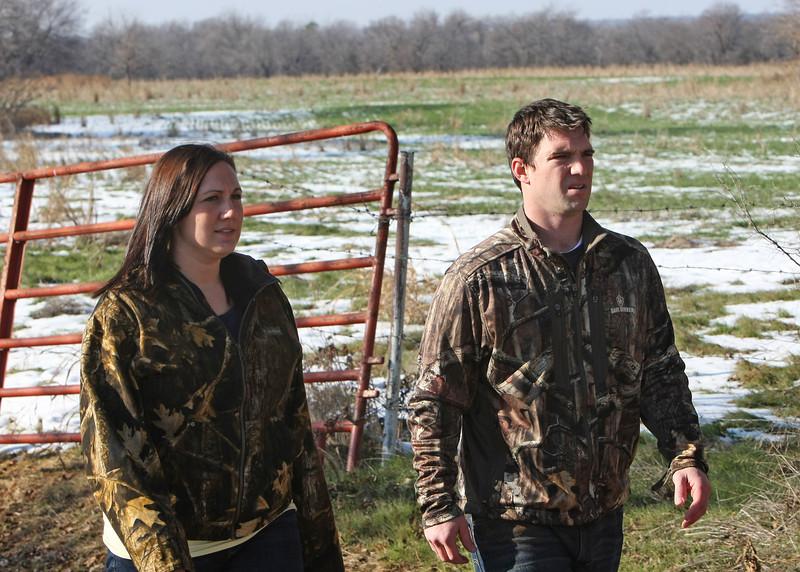 Feral hog hunters Jared and Jennifer Johnson of Owasso.
