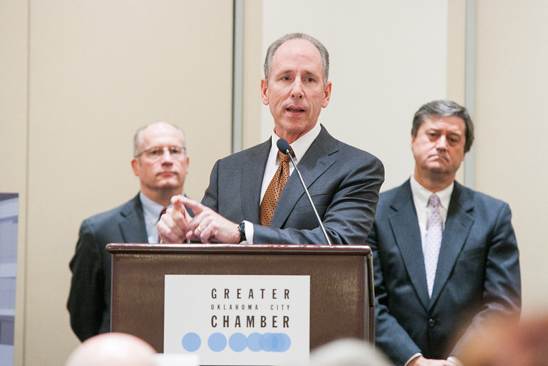 The Greater Oklahoma City Chamber of Commerce hosted a lunch to discuss the research facility GE is building in OKlahoma CIty, OK. Pictured from left to right, Micheal Ming and Mark Little with GE and Pete Delaney, chairman of the chamber.