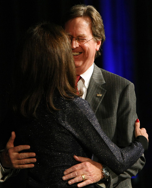 Tulsas mayor Dewey Bartlett Jr.  is hugged by his wife Victoria after being sworn into a second term.