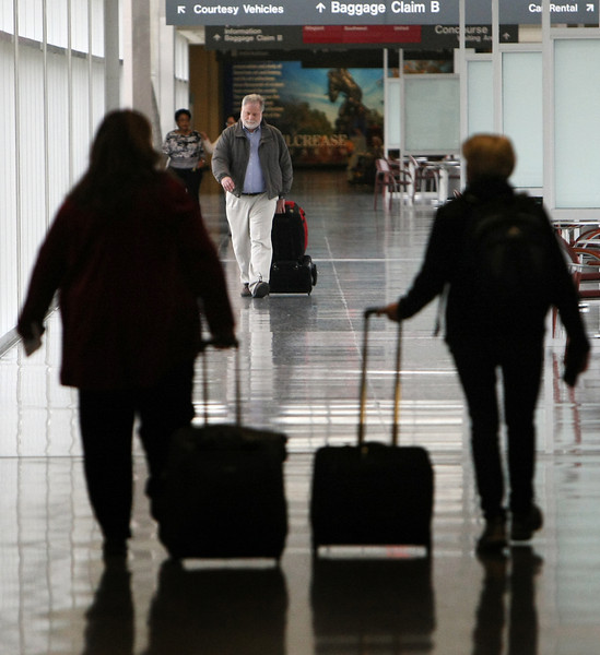 Travelers at the Tulsa International Airport Thursday.  Flights were at 100 percent capacity on Thursday at Will Rogers World Airport and will be full leaving Tulsa International Airport on Friday on what is expected to a record holiday travel season.