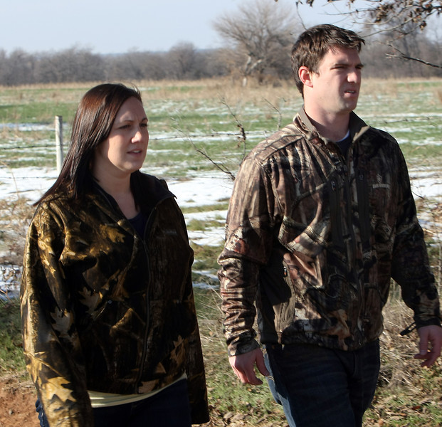 Feral hog hunters Jared and Jennifer Johnson of Owasso.