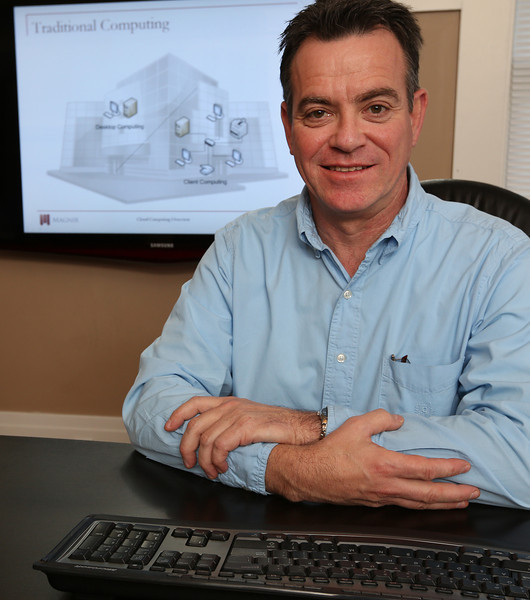 Fred Menge pauses for a photo at his Tulsa office.