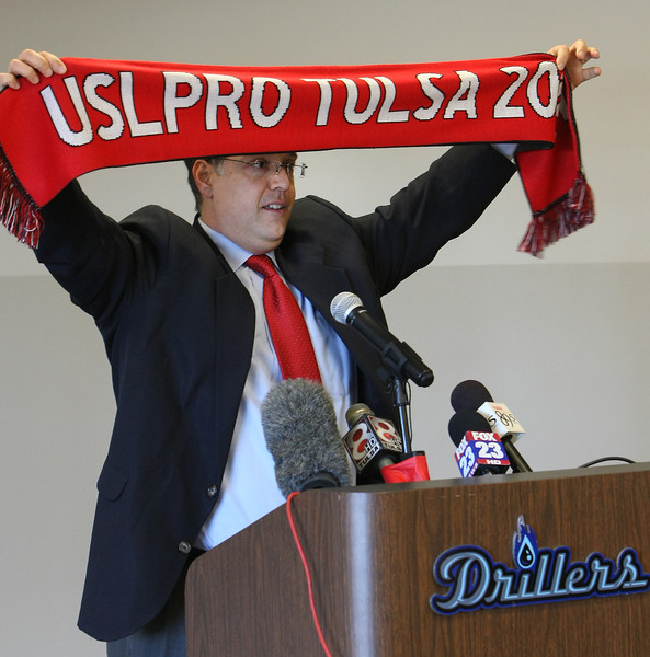 Tulsa Drillers General Manager Mike Melega hold a scar in celebration that the USL PRO has announced an expansion franchise in Tulsa and  will join the league for the 2015 season. The Tulsa Drillers of Minor League Baseball will be majority owners of the team with Prodigal LLC of Oklahoma City holding a minority interest in the squad.