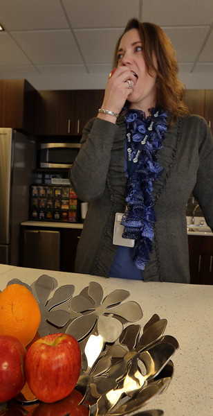 Michelle Griffith, Compensation and Benefits Administrator at Explorer Pipeline, grabs a healthy snack provided by the company.
