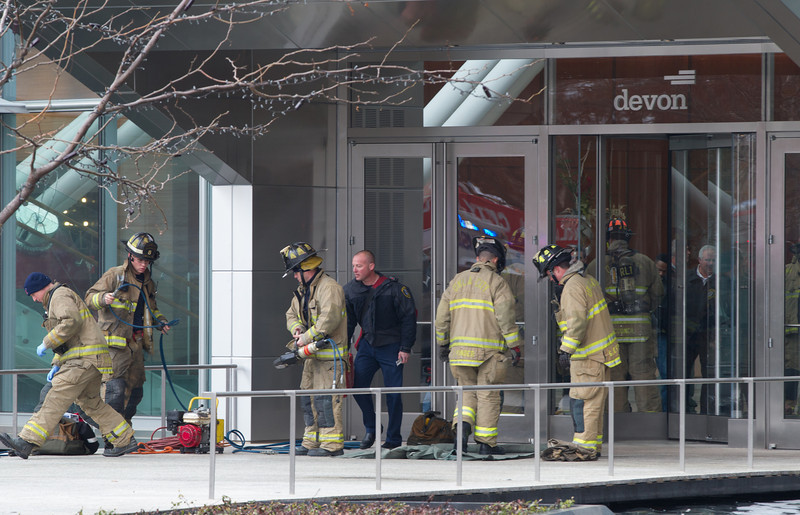 Oklahoma City police and fire departments responded to protesers at the Devon Tower in Oklahoma CIty, OK. Two of the protesters chained themselves to a revolvong door requiring fire and rescue to cut the chains.