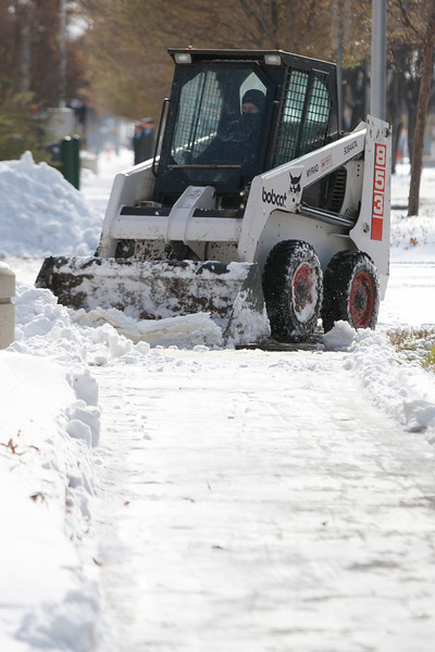 A bobcat clearing sidewalks in downtown Oklahoma City, OK.