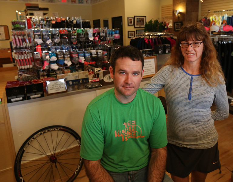 Owners of Tulsas Runners World Tulsa Derk Pinkerton and Kathy Hoover pause for a photo in their original location.  They are moving to a new location, 3920 S. Peoria, in early January and are expanding to add training for runners, spin and yoga and other fitness classes.