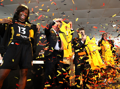 The new uniforms for the WNBA's Tulsa Shock are unveiled at a press conference.