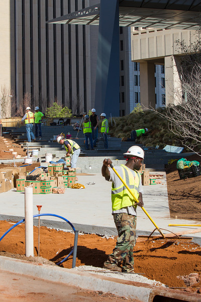 Crews working to complete the lanscaping on the Sandridge campus in downtown Oklahoma City.