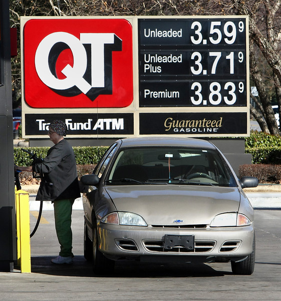 A customer fils her tank at a QT store in south Tulsa.