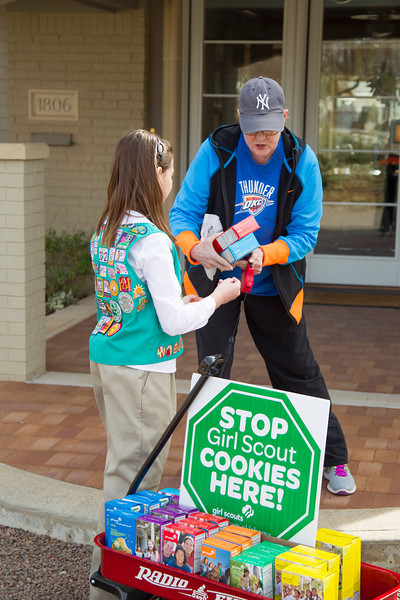 Jane Lofftis buy cookies from Girl Scout Katie Francis.
