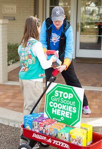 Jane Lofftis buy cookies from Girl Scout Katie Francis.