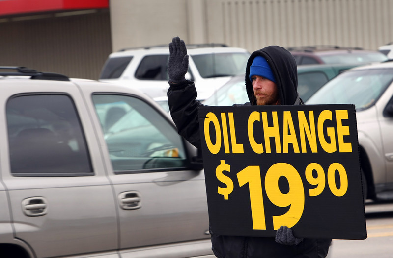 Jessie Dick works his way through a 10 hour daily shift of holding advertising signs at the 51st & Mingo intersection in south Tulsa.  <br /> <br /> The windchill was 22 degrees.  Brrrrr