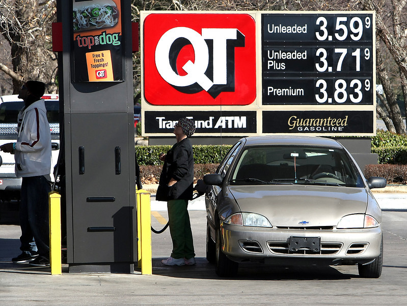 Customers fill their tanks at a QT store in south Tulsa.
