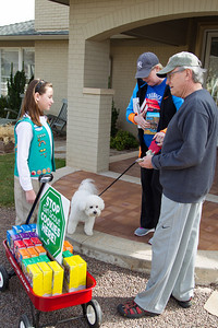 Jim and Jane Lofftis buy cookies from Girl Scout Katie Francis.