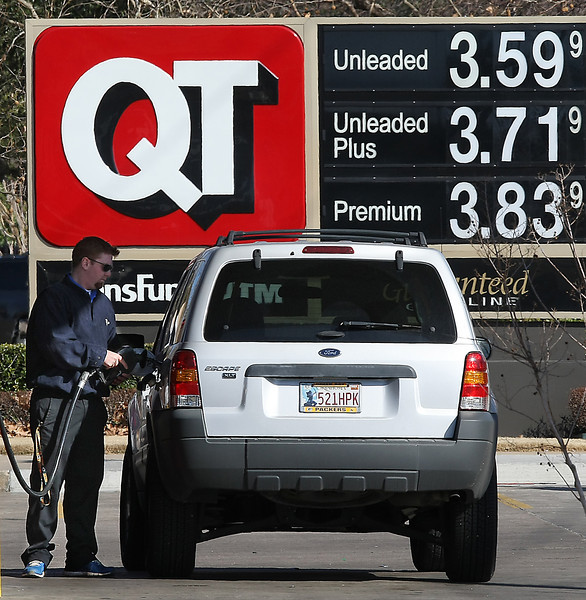 A customer fils his tank at a QT store in south Tulsa.
