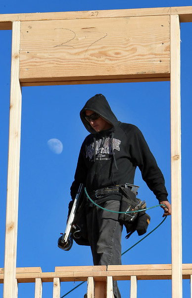 Albert Alvay works to build a home in south Tulsa.