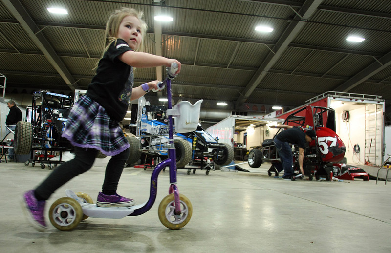 A young member of the racing community runs her own race prior to the Chili Bowl Nationals in Tulsa.