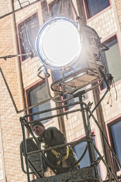 At the First National Center lighting is prepared for a commercial being filmed on the 5th floor.