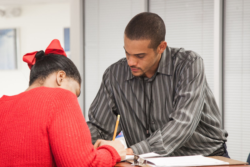 Workforce Specialist Nehemiah Pruitt checks in a client at the Oklahoma Employment Security Commision.