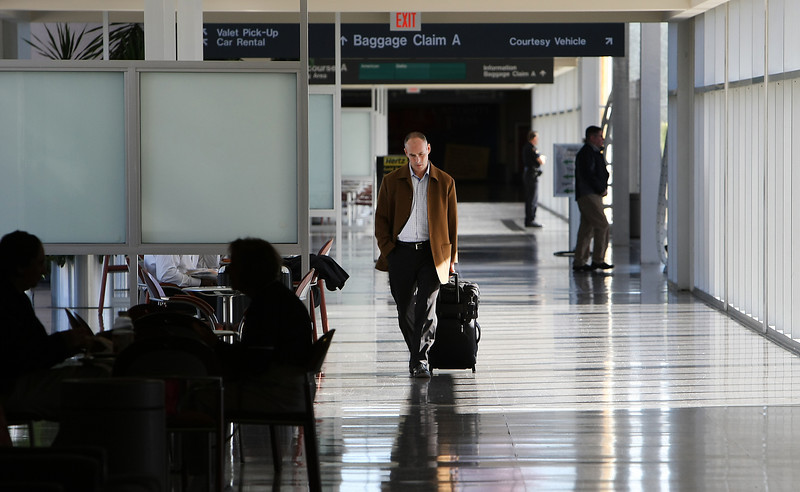 A traveler walks to his flight at the Tulsa International Airport.