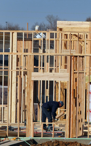 Construction crews work building the 286 unit Cascata apartments in south Tulsa.