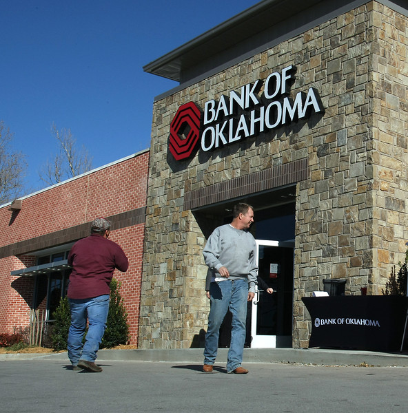 During the grand re-opening celebration customers admire the recently remodeled Bank of Oklahoma branch at 6505 E. 101st in Tulsa.