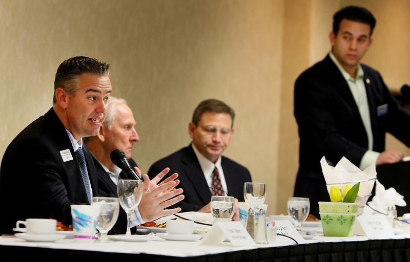 Sean Kouplen answers questions during a panel discussion at the NAIOP breakfast meeting in Tulsa.