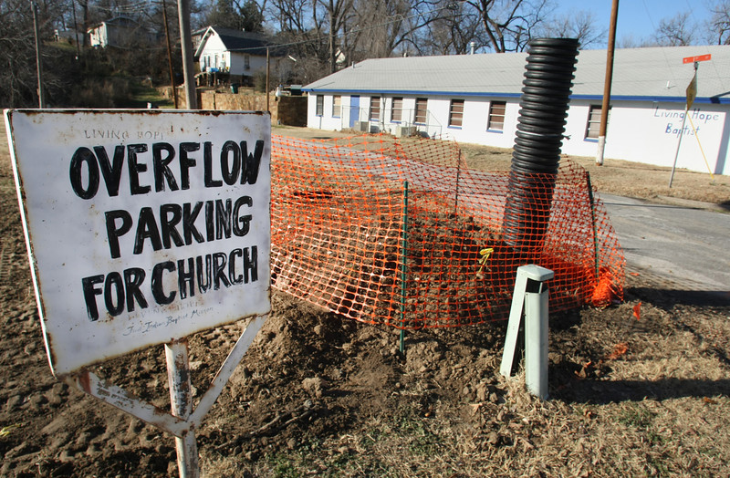 This is the site of a leaking un-cataloged old oil well theta had started to leak in the parking lot of the living hope baptist church near downtown Tulsa.  It had been temporarily stopped and covered up until utilities could be moved for the equipment needed to permanently cap the well.