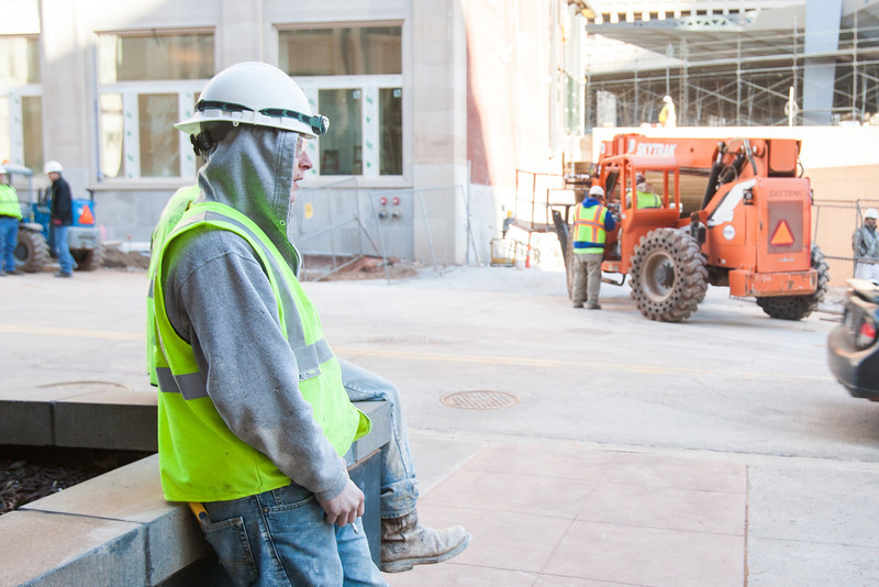 Construction workers taking a smoke break at the Sandridge Energy campus.