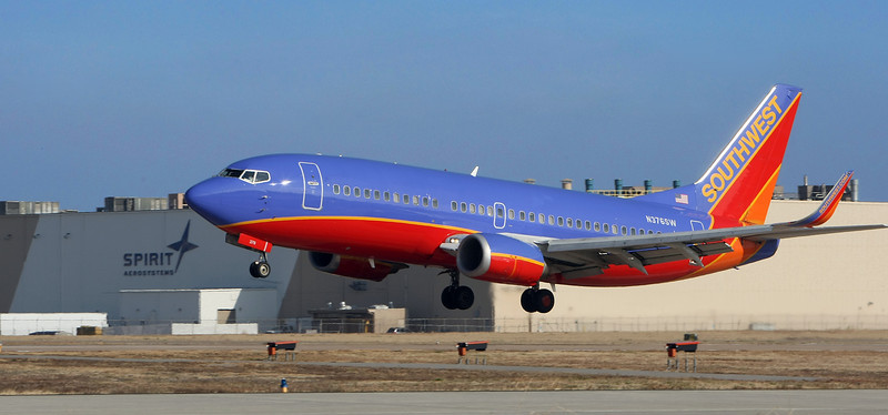 A Southwest Airlines jet lands on Tulsa International airport's 7,376 feet crosswind runway.  The final phase of a  3-phase $55 million project to completely reconstruct the airport's 9,999-foot primary runway resumed Wednesday, altering flight activity.
