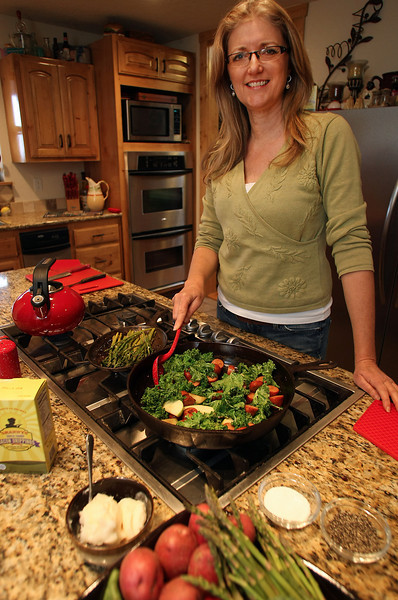 Jan Laub, President & CEO of Twin Foods, cooks a meal using her companies bacon grease substitute.