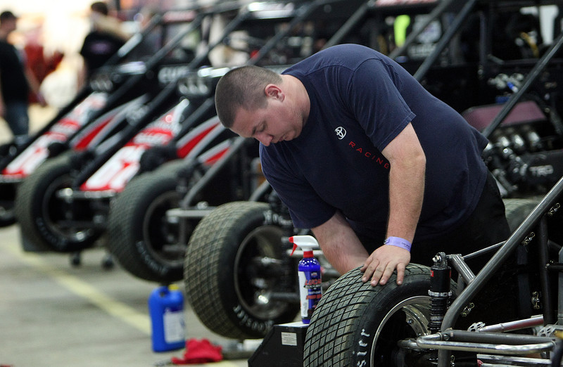 AJ Bray prepares midget race cars for the Keith Kunz Motorsport group prior to the Chili Bowl Nationals in Tulsa.
