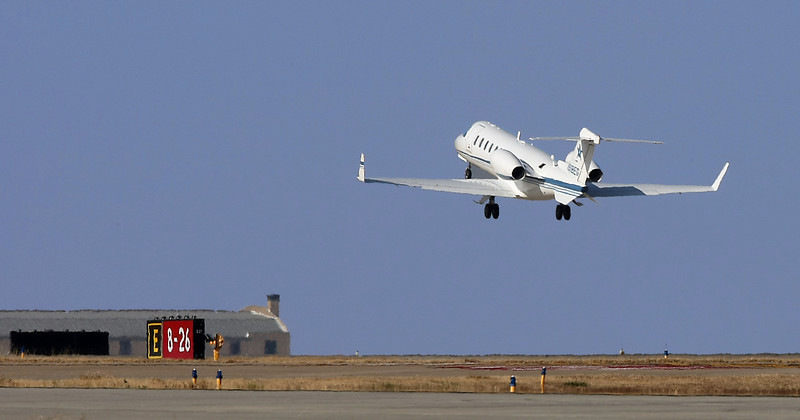 A business aircraft lifts off Tulsa International airport's 7,376 feet crosswind runway.  The final phase of a  3-phase $55 million project to completely reconstruct the airport's 9,999-foot primary runway resumed Wednesday, altering flight activity.