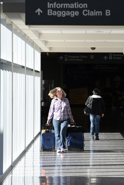 A traveler arrives at the Tulsa International Airport.